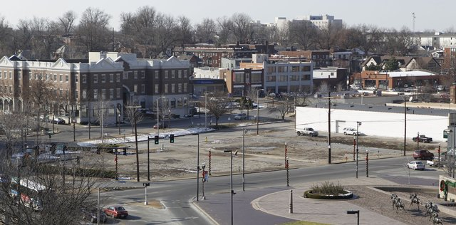 A Kentucky Utilities junction box complicated plans by CVS to build a pharmacy at the now-empty site bordering East Vine and East Main Streets in Lexington. CHARLES BERTRAM | STAFF | Kentucky.com