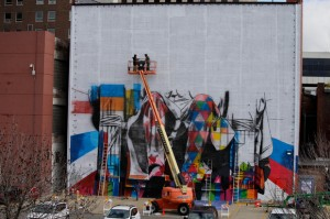 Kobra assistants Cezan Silva, left, and Agnaldo Britto map out a grid on the back of The Kentucky Theatre. Brazilian artist Eduardo Kobra is painting a mural on the back wall of The Kentucky Theatre. The sixty foot building will sport the artists interpretation of an iconic image from the 19th Century. Kobra and his assistants continued work on the mural, Thursday, Nov. 07, 2013 at Kentucky Theatre in Lexington. | Photo by Jonathan Palmer | Kentucky.com
